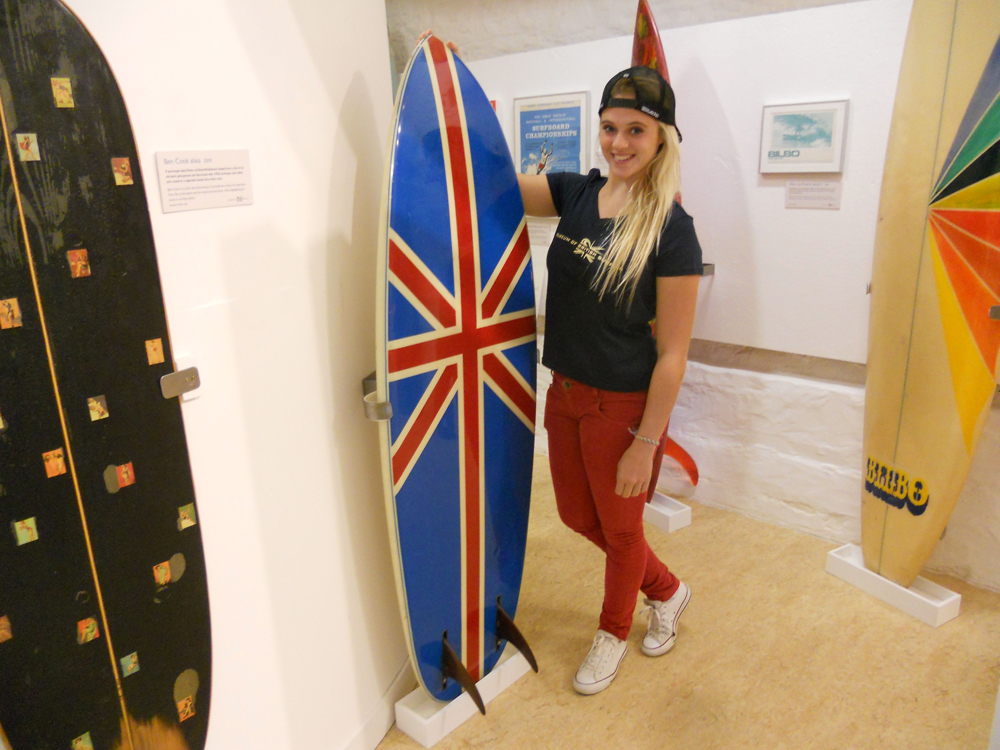 Surf champ scoops prize as museum's 2,000th visitor